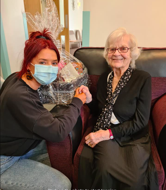 Student Lucy Greetham with resident Marjorie Jesperson